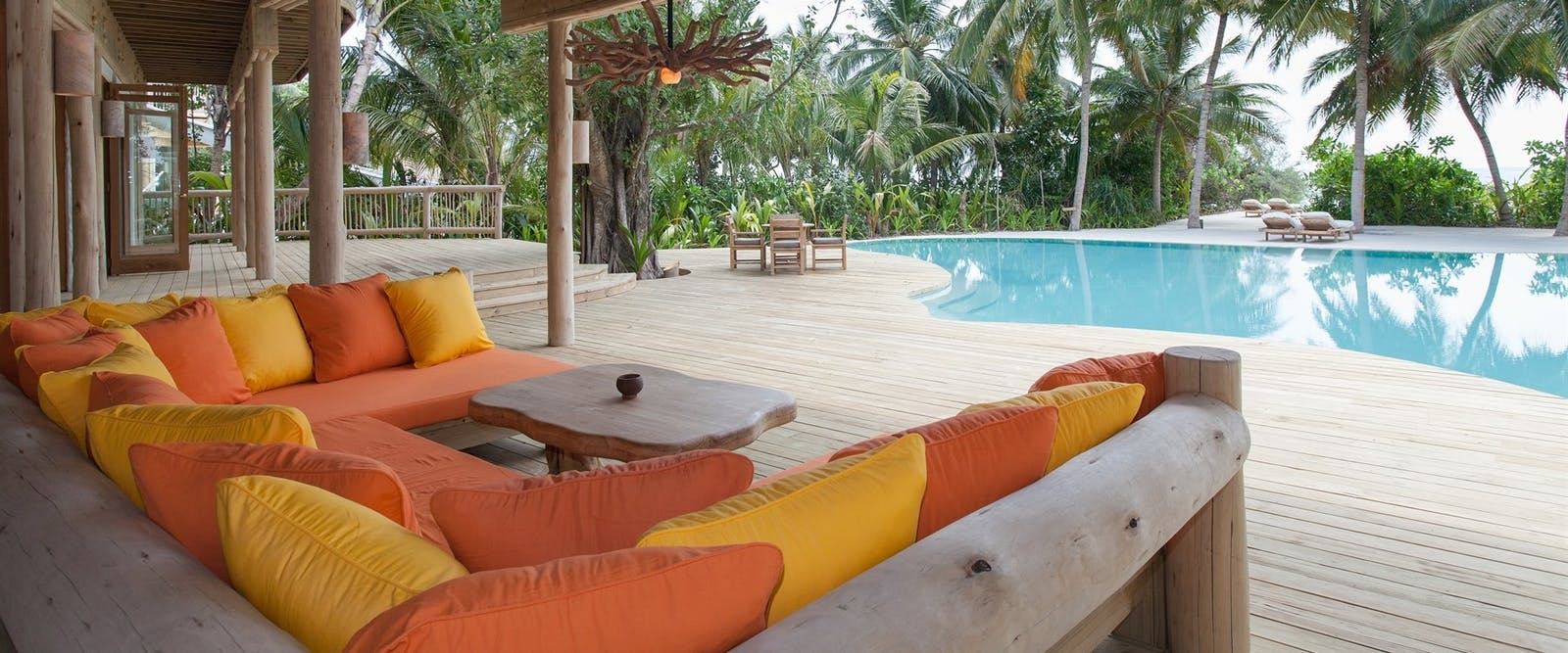 Daybed next to the pool in Villa 14 at Soneva Fushi, Maldives, Indian Ocean