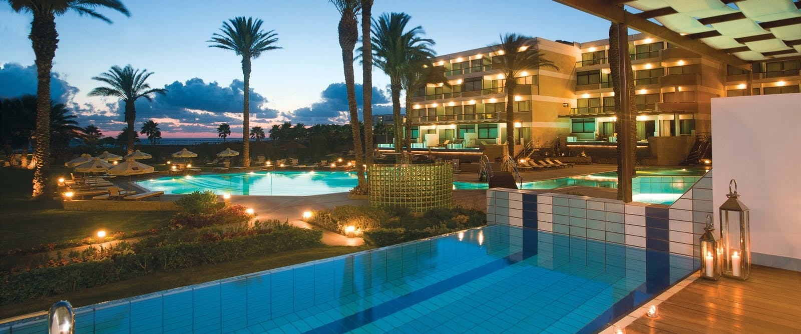 Swimming Pool in the Evening at Constantinou Bros Asimina Suites Hotel, Paphos, Cyprus