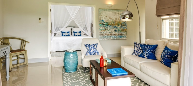 Living room area in Deluxe Suite at Calabash Luxury Boutique Hotel & Spa