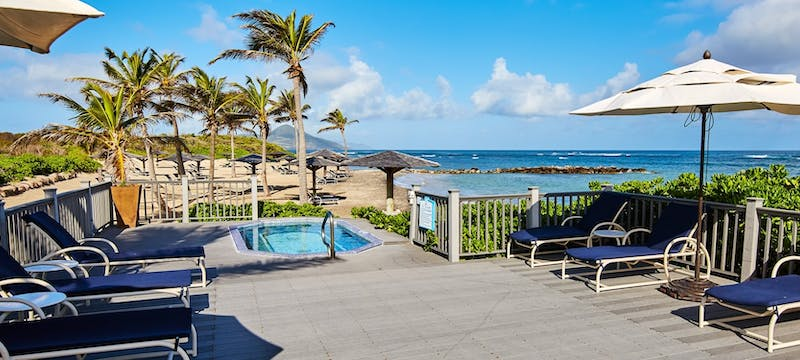Terrace with jacuzzi overlooking the ocean at Nisbet Plantation Beach Club, Nevis
