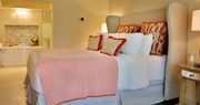 Bedroom and bathroom in Verandah Suite at Rendezvous, St Lucia