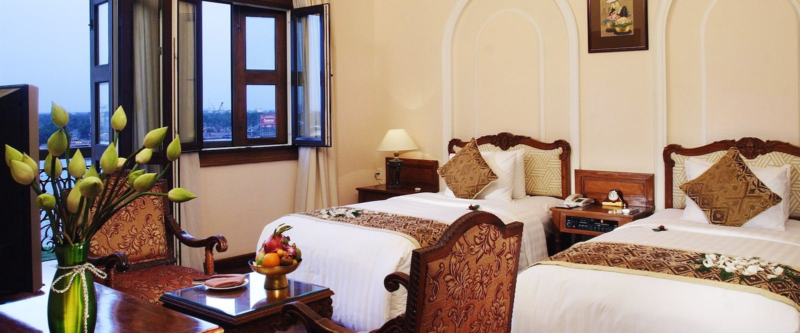 Classic saigon river deluxe bedroom at Hotel Majestic