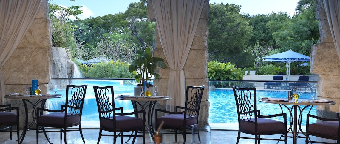 Casual dining cafe cocooned by the cascading waterfall at Sandy Lane, Barbados