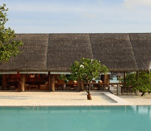 The bar and pool area at COMO Cocoa Island, Maldives