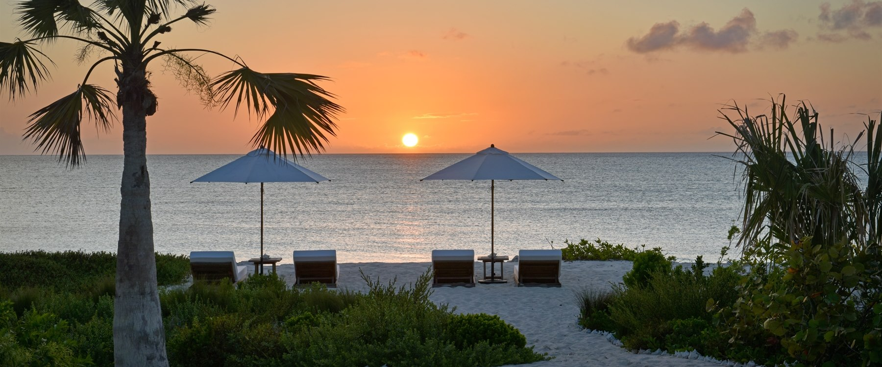Pumpkin main house beach at sunset at COMO Parrot Cay, Turks and Caicos