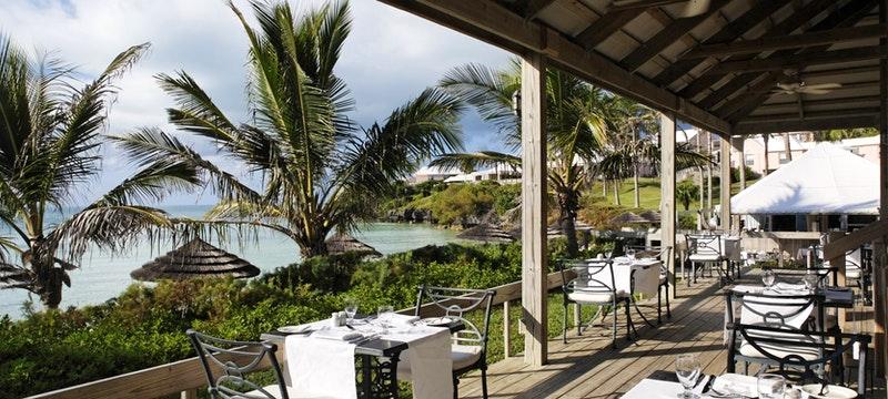 Waterfront alfresco restaurant at Cambridge Beaches Resort & Spa, Bermuda
