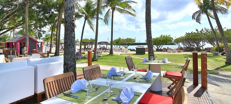 Outdoor terrace dining at La Creole Beach Hotel & Spa