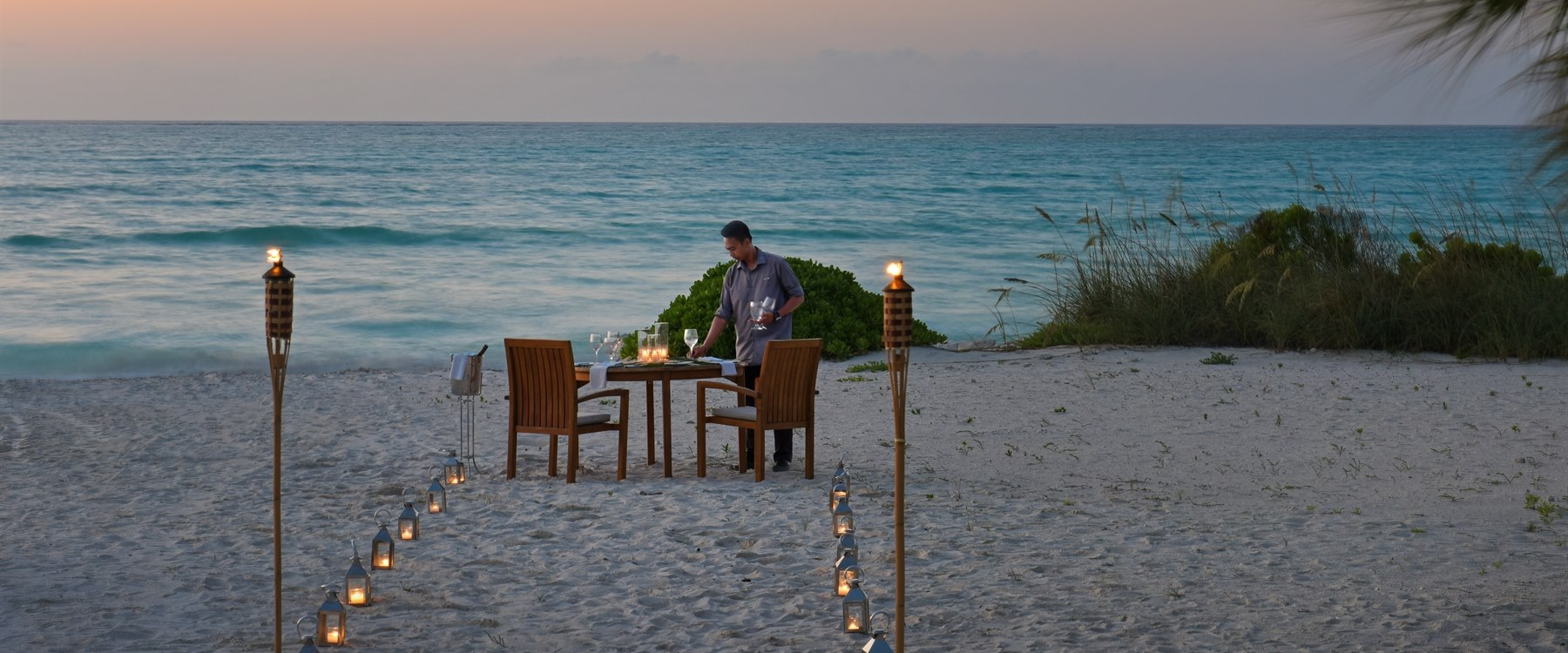 Set up romantic beach dinner at COMO Parrot Cay, Turks and Caicos