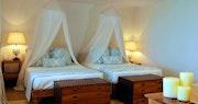 Twin room at Carenage Villa, Canouan