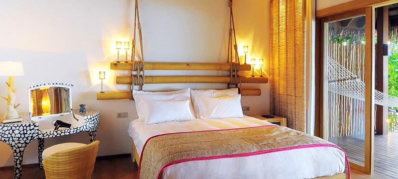Beach Villa Bedroom at Constance Moofushi, Maldives