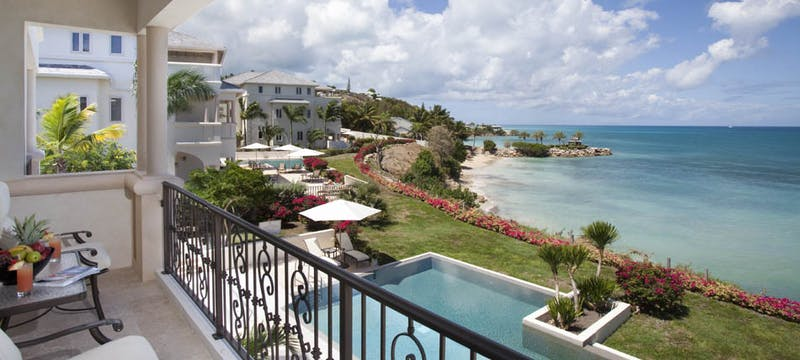 Enjoy the ocean views on a private terrace at Rock Cottage at Blue Waters, Antigua