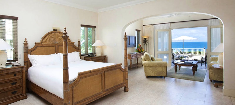 Spacious bedroom leading to private terrace at Rock Cottage at Blue Waters, Antigua