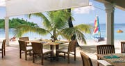 Enjoy beach-side dining at Curtain Bluff, Antigua