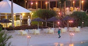 Indulge in dinner on the sand at Cambridge Beaches Resort & Spa, Bermuda