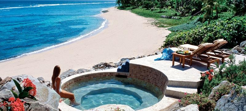 Jacuzzi overlooking the shore at Peter Island Villa Estates, British Virgin Islands
