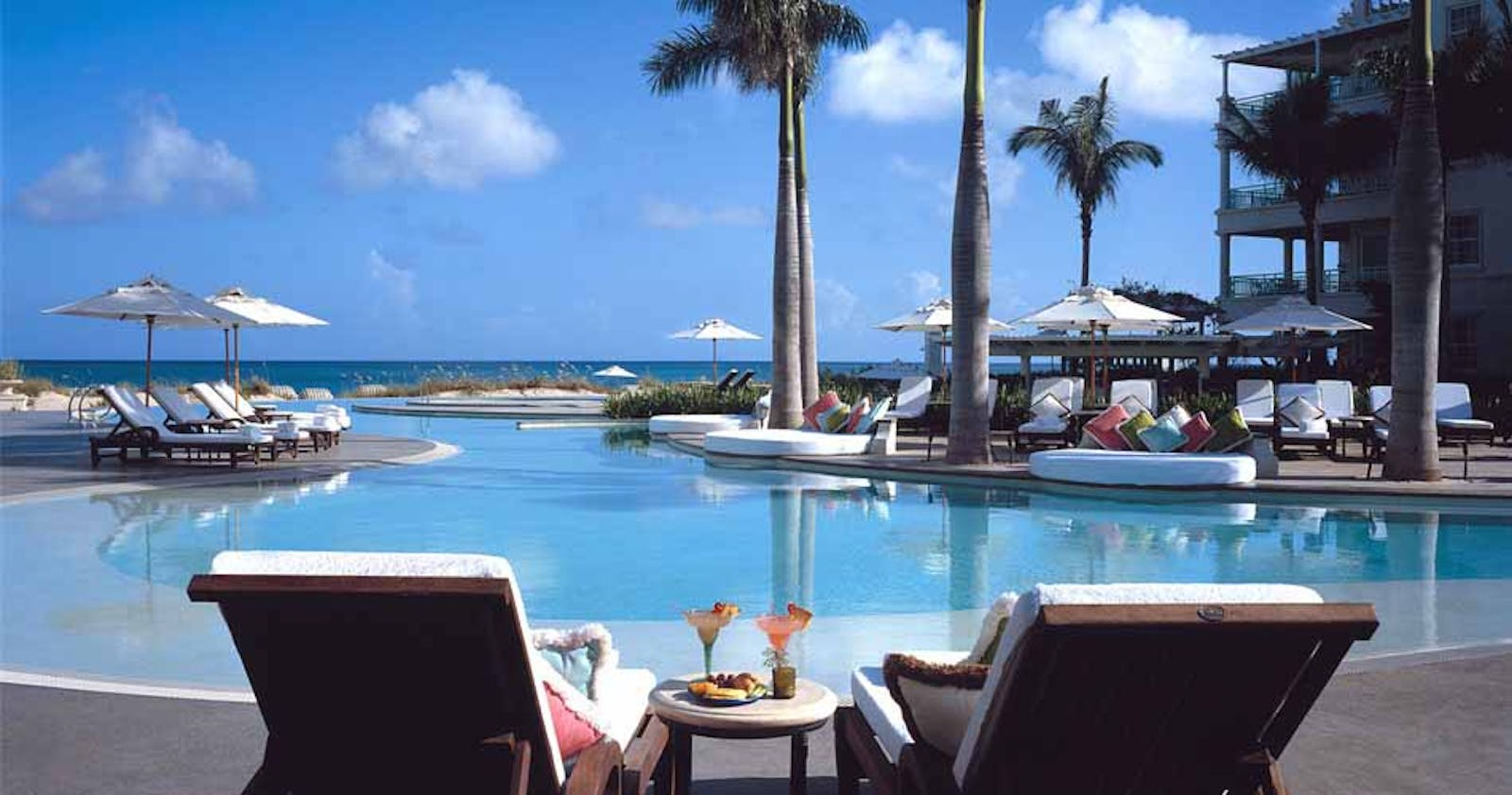 Poolside relaxing at The Regent Palms Turks & Caicos