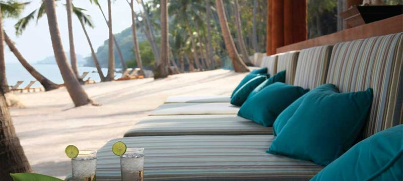 Relax with a cocktail at Four Seasons Resort Koh Samui, Thailand