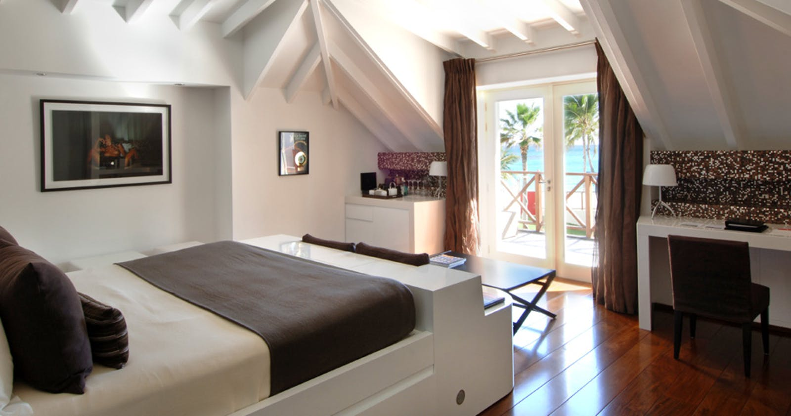 Bedroom overlooking the ocean in Rockstar Villa at Rockstar & Nina at Eden Rock
