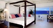Bedroom overlooking the ocean at Round Hill Villas, Jamaica
