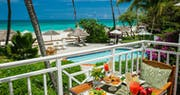 The terrace in the Honeymoon Beachfront Butler Suite at Sandals Grande Antigua