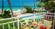 The terrace in the Honeymoon Beachfront Butler Suite at Sandals Grande Antigua