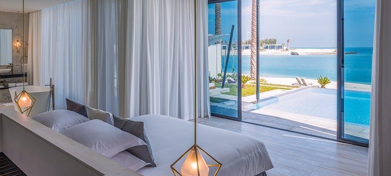 Beach Villa bedroom at Zaya Nurai Island