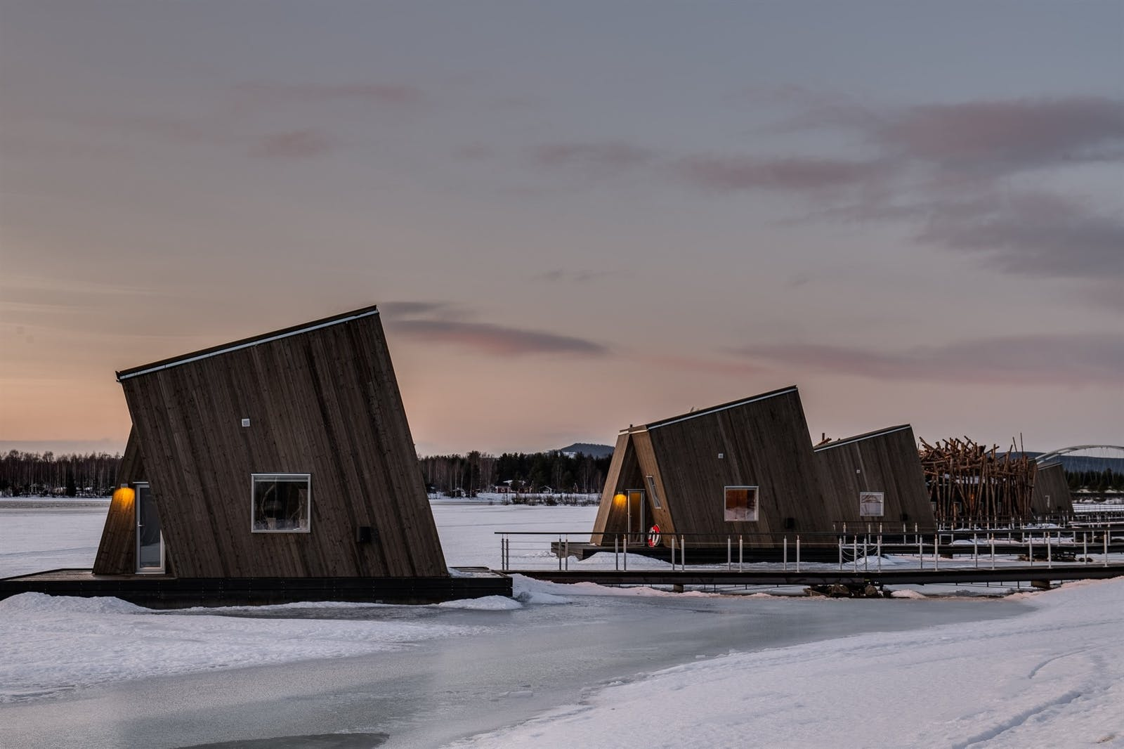 Floating Cabins connected to the shore by a floating walkway, Arctic Bath, Sweden