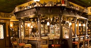 Embrace the welcoming experience of a traditional, British pub at Sandals Emerald Bay, Bahamas