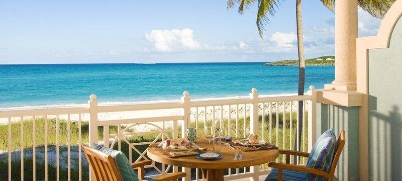 Suite balcony overlooking the beach at Sandals Emerald Bay, Bahamas