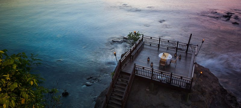 Private dining looking over the shore at Cap Maison, St Lucia