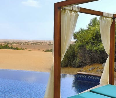 Infinity pool at Al Maha, a Luxury Collection Desert Resort & Spa