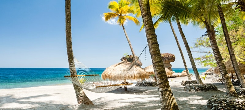 Relax on a hammock next to the ocean at Anse Chastanet, St Lucia
