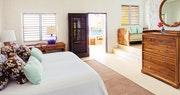Sea view bedroom at Tennis courts at Guana Island, British Virgin Islands