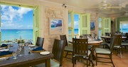 An open air covered terrace offering unbelievable views of the Caribbean Sea at Little Good Harbour, Barbados