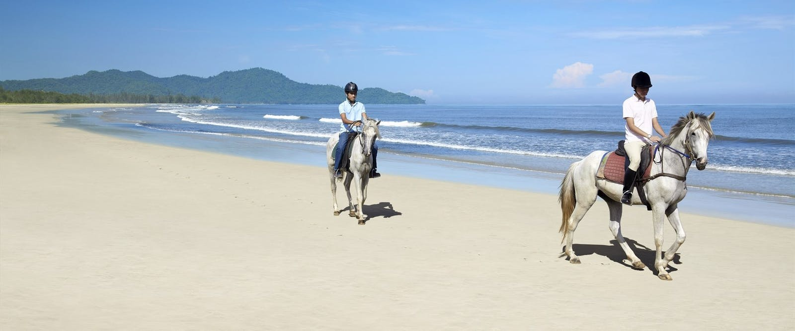 Horseriding on the beach at Shangri La Rasa Ria Resort, Borneo