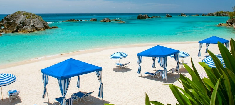 Relax in a cabana on the beach at Fairmont Southampton, Bermuda