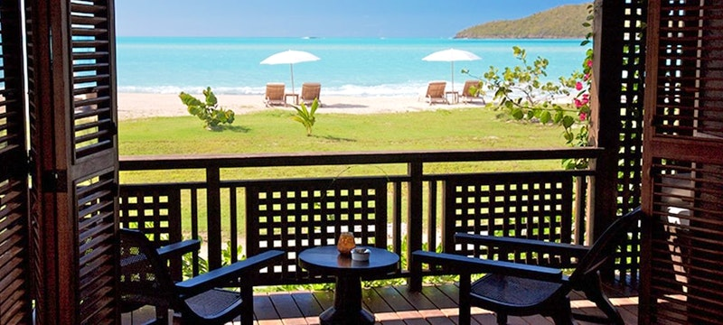 Beachfront suite with unobstructed views of the Caribbean Sea at Hermitage Bay, Antigua