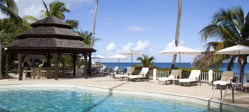 Main pool with ocean view at Blue Waters, Antigua