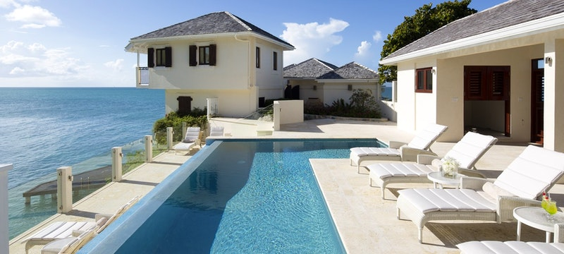 main pool with ocean view at blue waters antigua