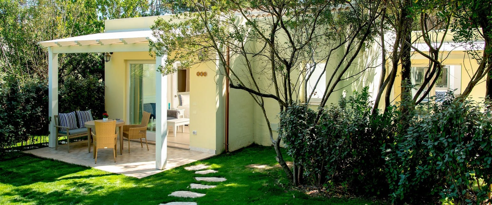 Deluxe Bungalow Exterior at Forte Village Hotel Bouganville, South Sardinia, Italy