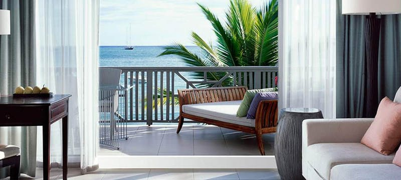 A private balcony with ocean view in the Carlisle Suite