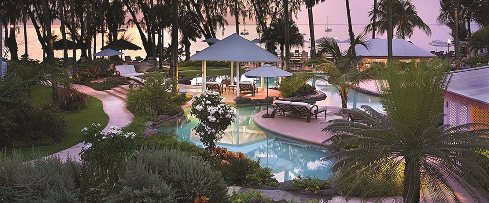 Pool in the evening at Colony Club by Elegant Hotels, Barbados, Caribbean