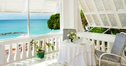 Relax on your private balcony in the Camelot Suite at Cobblers Cove, Barbados