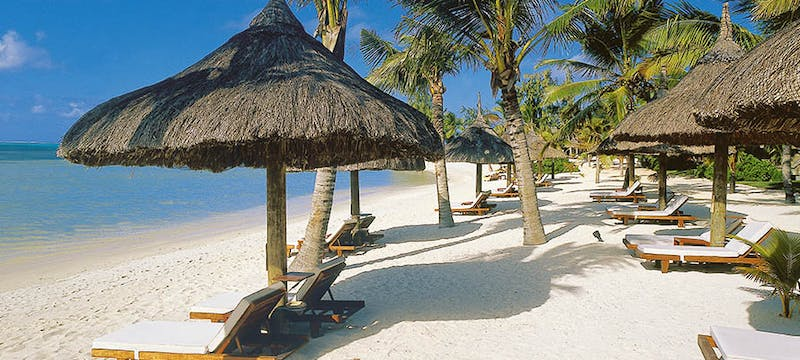 Sun loungers on the beach at Constance Le Prince Maurice, Mauritius