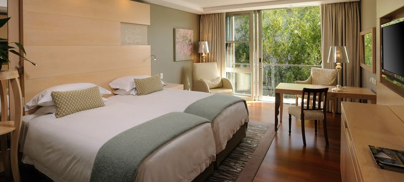 Deluxe Courtyard bedroom at The Vineyard Hotel