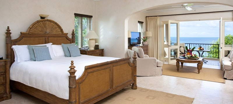 Spacious suite bedroom overlooking the ocean at The Cove Suites At Blue Waters, Antigua