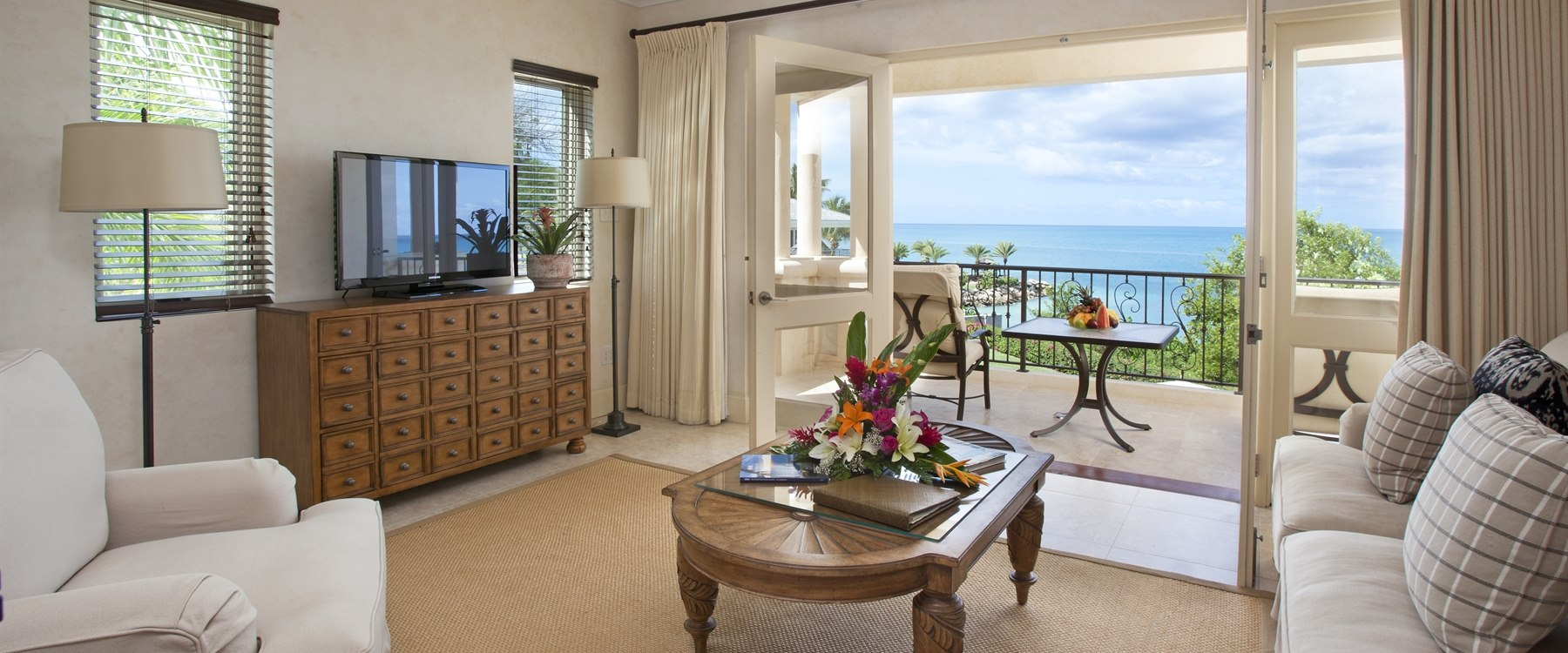 Suite bedroom lounge area within The Cove Suites at Blue Water, Antigua