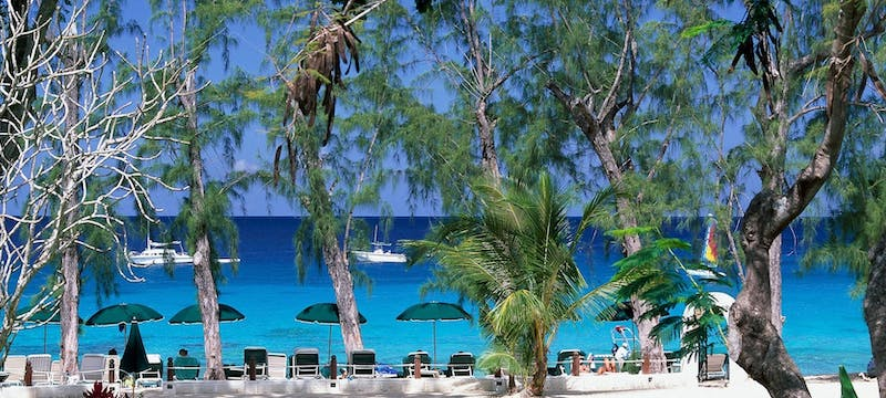 Relax along the shore line at Coral Reef Club, Barbados