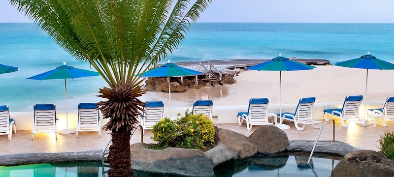 Relax by the pool at Crystal Cove, Barbados