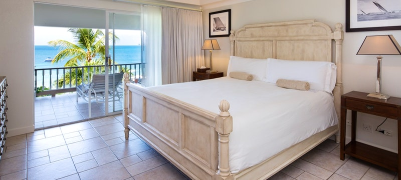 view from deluxe beachfront bedroom at blue waters antigua
